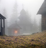 wooden church in mountains