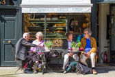 Elderly Couples At A French Patisserie