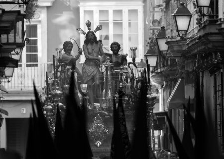 Holy Week in Cadiz,Spain. Jesus tied to the Column and Whips and Holy Mary of Tears, The Column. B&W.