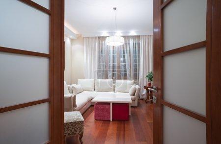 View to a living room through open door