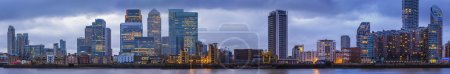 Detailed, high resolution panoramic photo about the skyscrapers of Canary Wharf at blue hour - London, UK