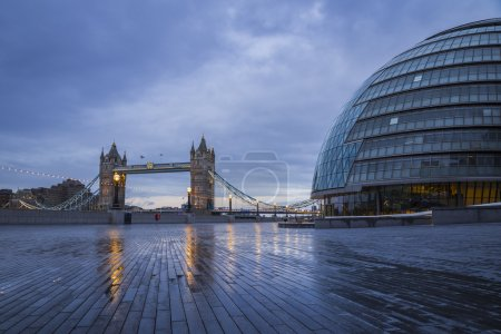 The iconic Tower Bridge with the City Hall building on an early winter morning - London, UK