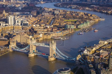 London, England - Aerial view of the famous Tower Bridge with Red Double Decker Bus at sunset