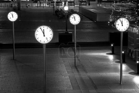 Clocks of Canary Wharf by night, London, UK