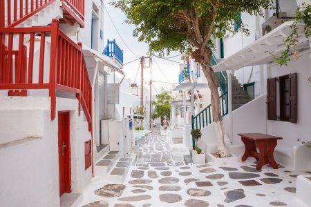 Mykonos town streetview with tree and red banisters, Mykonos town, Greece