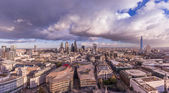 Panoramic skyline of London with Bank district including Stock Exchange Tower, Willis Building, Tower 42, Gherkin, Lloyd`s of London, the Shard and Canary Wharf at the background.