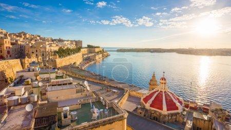 The old harbor of Valletta with church roof at sunrise - Valletta, Malta