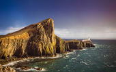 The famous Neist Point Lighthouse minutes before a heavy strom on the Isle of Skye - Scotland, UK