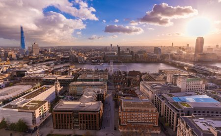 Panoramic skyline view of south London from the top of St.Paul's Cathedral at sunset with blue sky and clouds and River Thames - London, UK