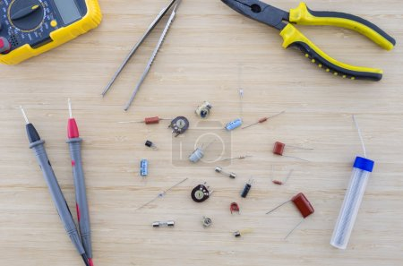 Photo for The radio parts and tools on the wooden table. Workplace. Top view. - Royalty Free Image