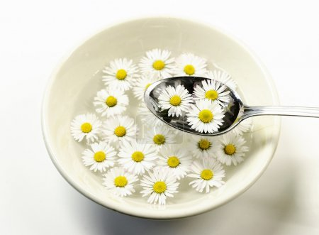 ceramic bowl with daisy flowers and spoon