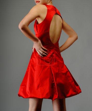 Elegant woman in luxury fashion red dress