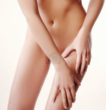 Woman with slim body massage with moisturizing cream