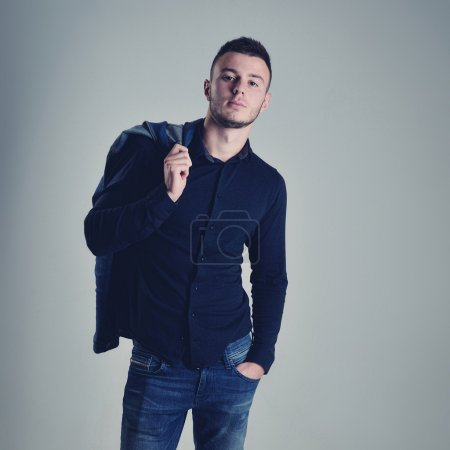 Photo for Handsome guy posing in stylish jeans clothes - Royalty Free Image
