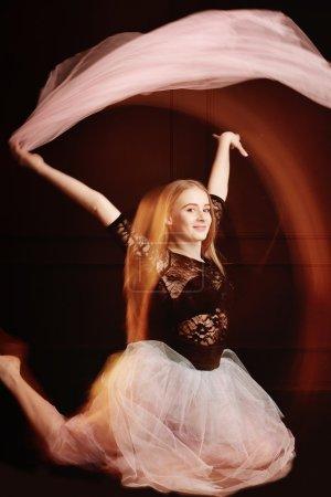 young beautiful dancer girl dancing and jumping, studio