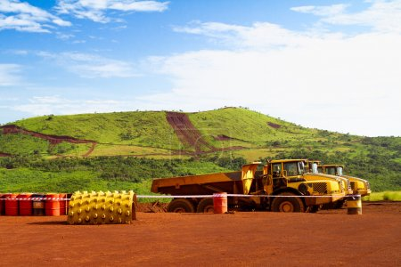 Articulated haul trucks on mine site in Africa