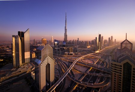 Sunset near Burj Dubai from the roof in city