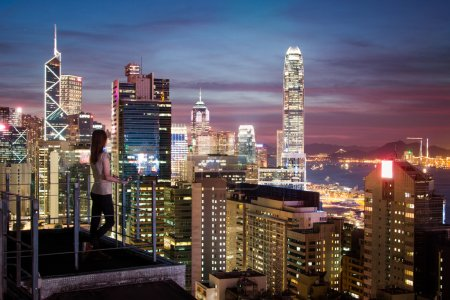 tity girl is wathing sunset from the roof of Hong Kong