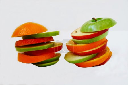 slices of green and red Apple and orange