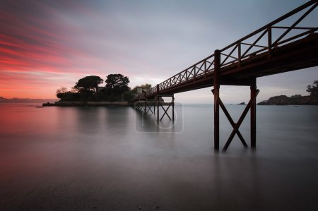 Photo for Isle of Santa Cruz de Oleiros, Galicia, Spain. View of bridge at beautiful sunset - Royalty Free Image