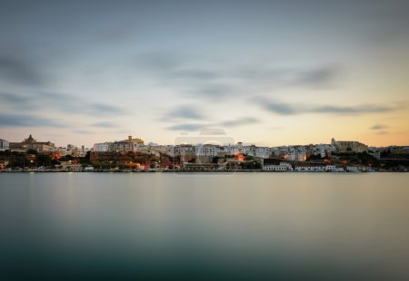 Photo for Mao town view from sea at sunset, Capital of Mahon Island, Spain - Royalty Free Image