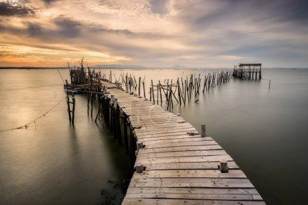 Photo for Carrasqueira old wooden pier at sunset, Soain - Royalty Free Image