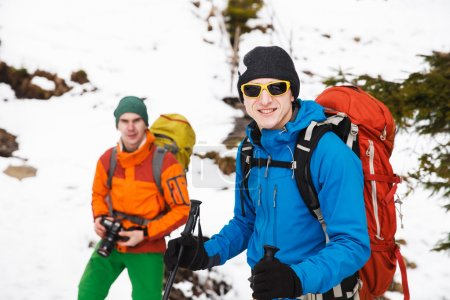 Two hikers in winter mountains
