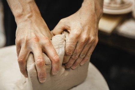 unrecognizable potter master preparing the clay