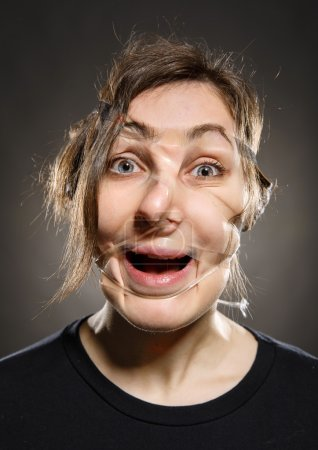 Portrait of scotch taped face woman