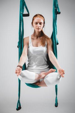 Antigravity Yoga - meditation position. Stock Image