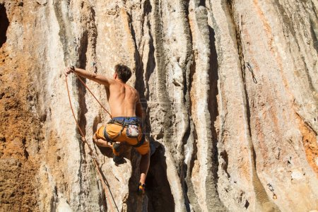 Photo for Rock climber on the wall - bold choice of real men. Dangerous adventure. Turkey, Geyikbayiri - Stock Image. - Royalty Free Image