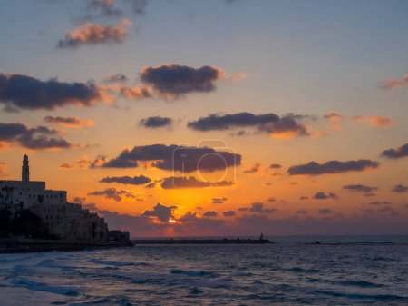 Coastal view of the ancient city of Yafo or Jaffanear Tel Aviv, Israel. Cityscape in sunset hour with clouds in the sky. High quality photo