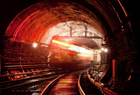 Train moving across tunnel