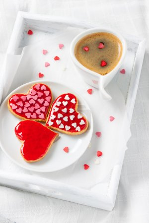 cup of coffee and heart biscuits