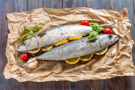 Fresh raw mackerel with lemon, tomatoes and spices...