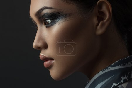 Photo for Portrait of beautiful asian girl with creative art make up. Picture taken in the studio on a black background. - Royalty Free Image