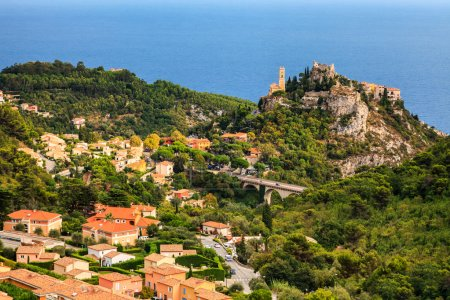 Eze Village in Alpes-Maritimes department in southern France                       Stock Photo:   Church Our Lady of Assumption was built by an Italian architect Spinelli between 1764 and 1778 in Eze. Eze is a s