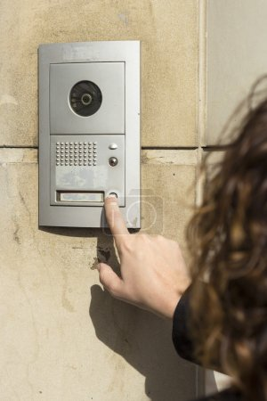 Woman  calling on the intercom