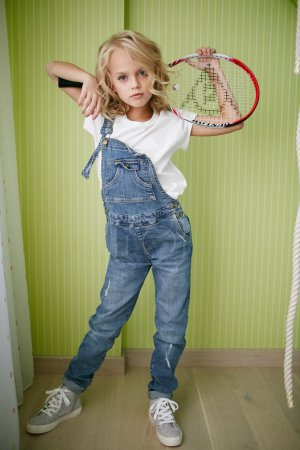 Teen beautiful girl in jeans clothes with tennis racket