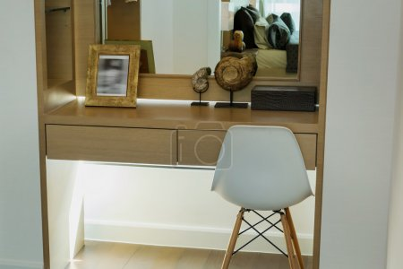 modern dressing table with picture frame and glass mirror
