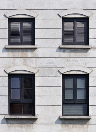 Black frame and shuttered window