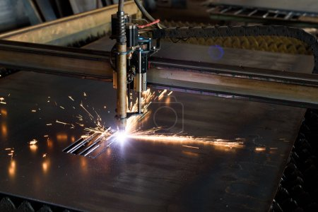 Metal grinding with bright orange flying sparks