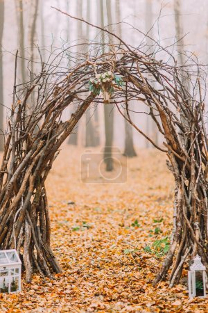 Creative cute decorated wedding arch and all exterior of holidays on the background autumn  lake