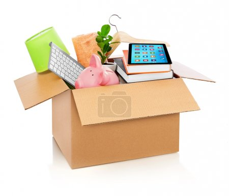 Photo for Box full of household stuff, white background - Royalty Free Image