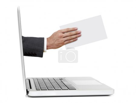 Hand with paper out of laptop