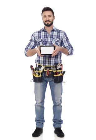 Handyman holding tablet