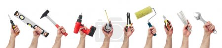 Photo for Hands raised holding different tools - Royalty Free Image