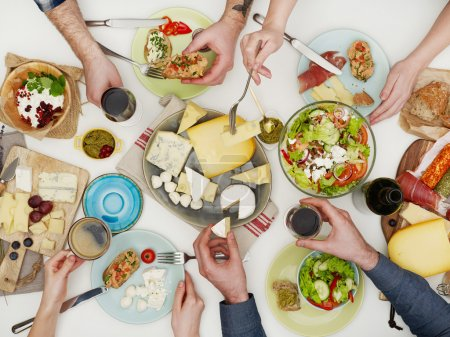 Photo for View from above the table of people eating - Royalty Free Image
