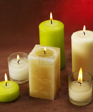 Photo for Spa candles on red background - Royalty Free Image