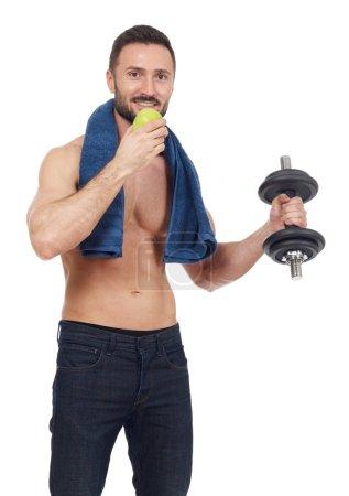 Healthy sportsman on white